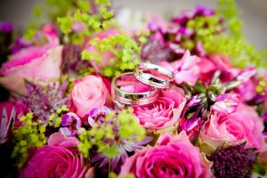 Wedding rings and pink flowers